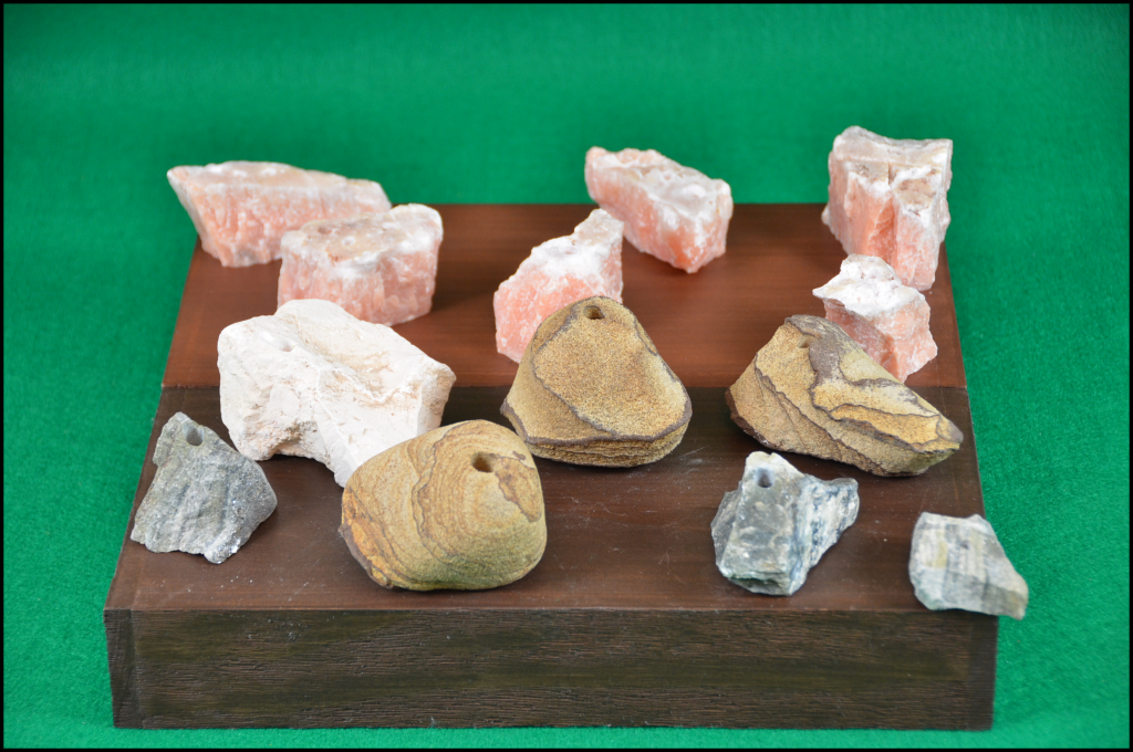 Our hand crafted rock bud vases come in a variety of shades and sizes